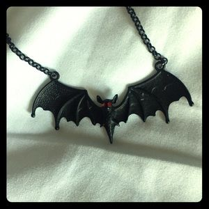 Bat necklace with red jewel eyes